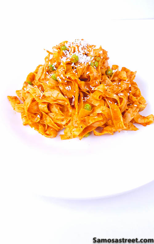 Fettuccine pasta in roasted tomato and onion sauce.